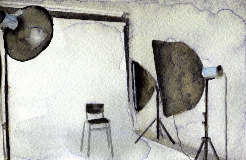 watercolor sketch of empty photo studio with lighting equipment