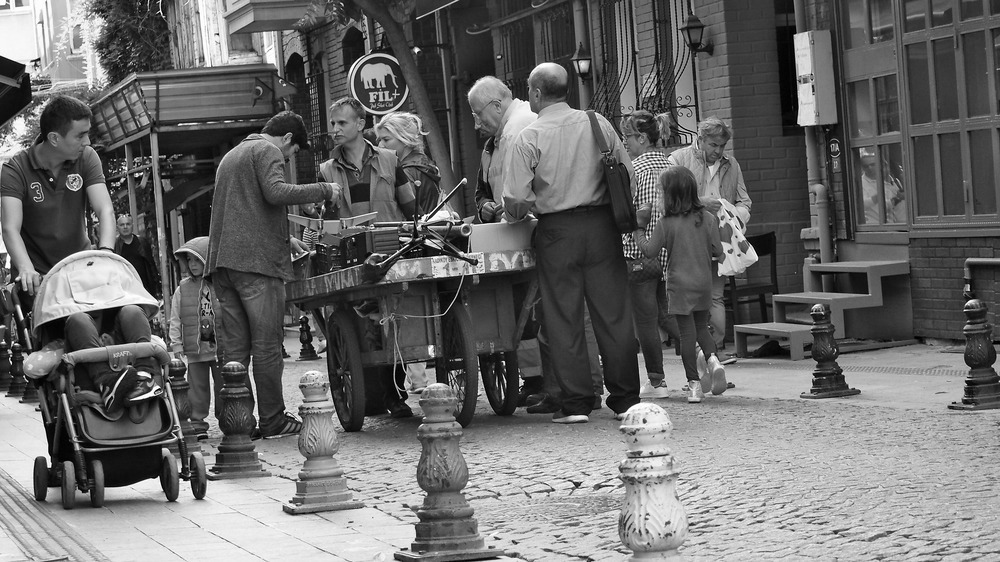 man sells odds and ends from his cart to passer byers on the Asian side of Istanbul