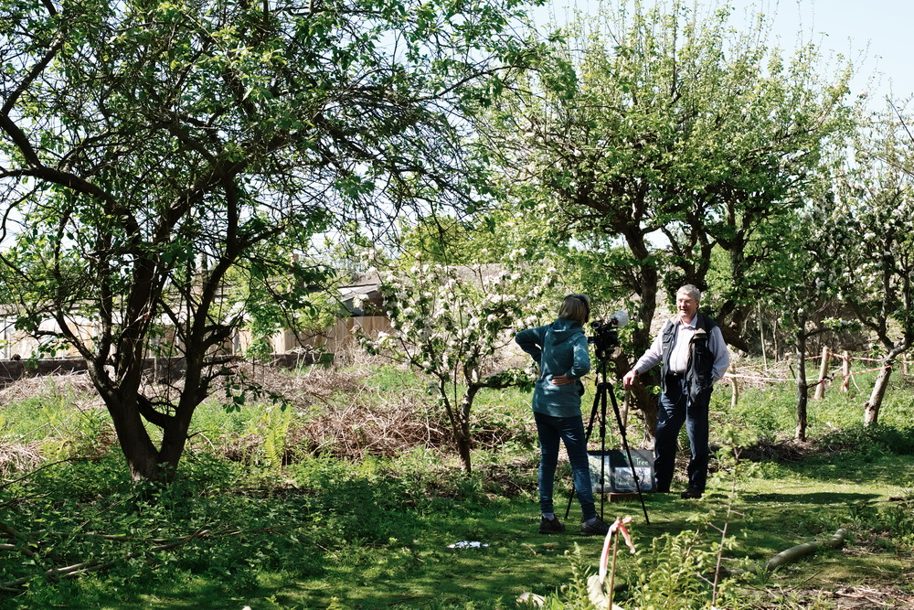 interview in garden with fruit trees