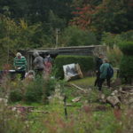 community gardeners working in walled garden