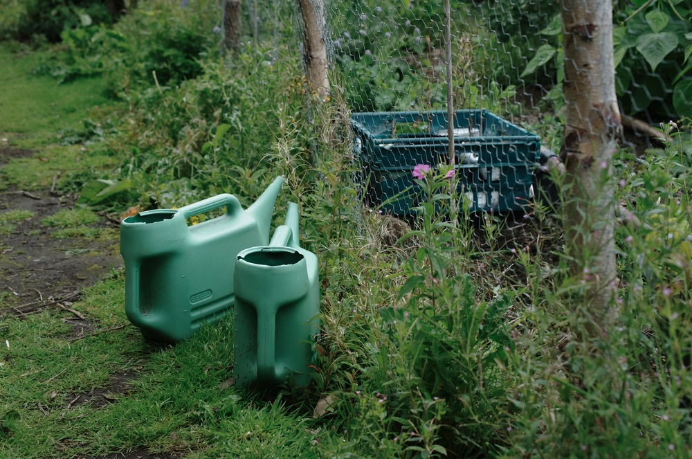 two watering cans community garden edinburgh scotland
