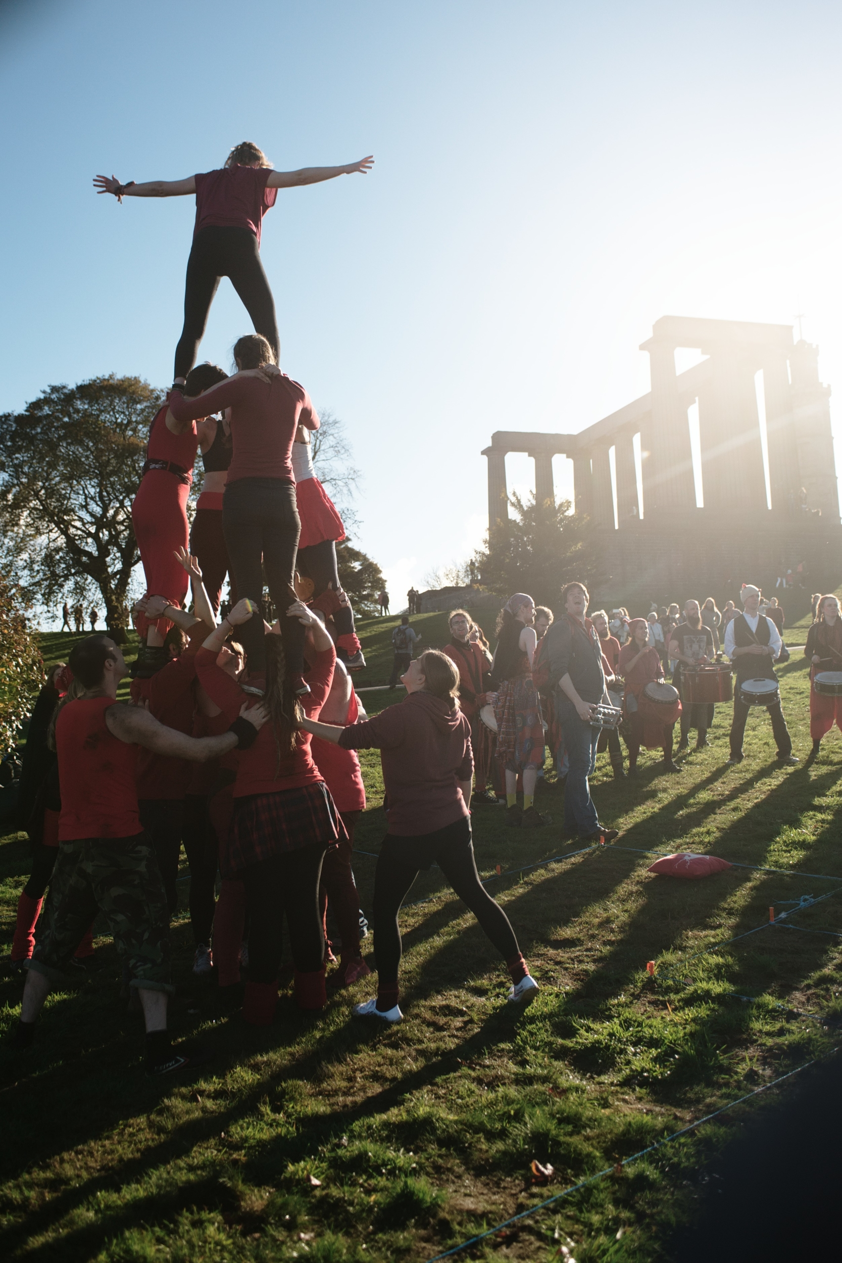 Beltane fire society acrobats perform on calton hill
